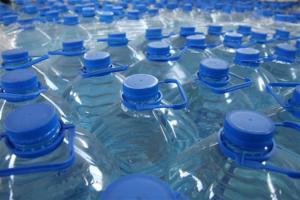 Pre-packed bottled water in plastic bottles